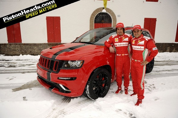 Alonso and Massa stand in front of their new 'ride'. Presumably to hide its hideousness