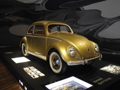 1955 Beetle was millionth VW. Decoration makes it look like a Damien Hirst installation