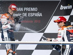 Stoner and teammate Pedrosa celebrate