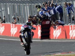Lorenzo crosses the line in style