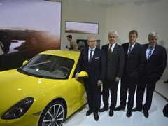 Hatz (right) with the Porsche bigwigs at LA