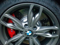 Red calipers and (fake) drilled rotors bring bling