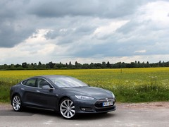 Even in muted grey the Tesla turns heads aplenty