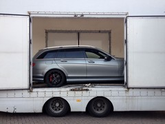 Sad times; the C63 is loaded up and whisked away