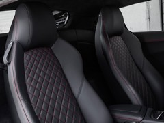 Power seats on standard, fixed-back for Plus