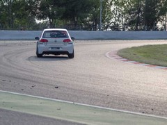 Golf in rare moment out on track...