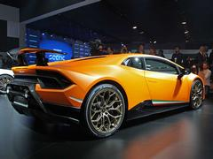 It's a Lambo, of course it's orange with gold wheels