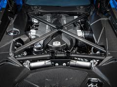 740hp at 8,400rpm. Proper V12