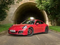 Manual, rear-wheel drive, very red - it's a nice spec